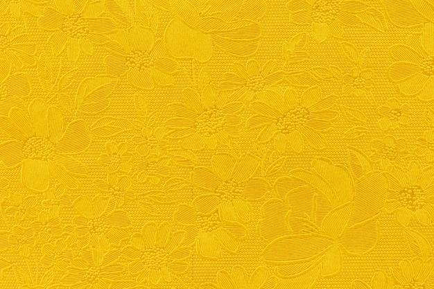 ゴールドの花柄の錦織の織物のパターン。金色の背景のテクスチャ。デザインの要素。