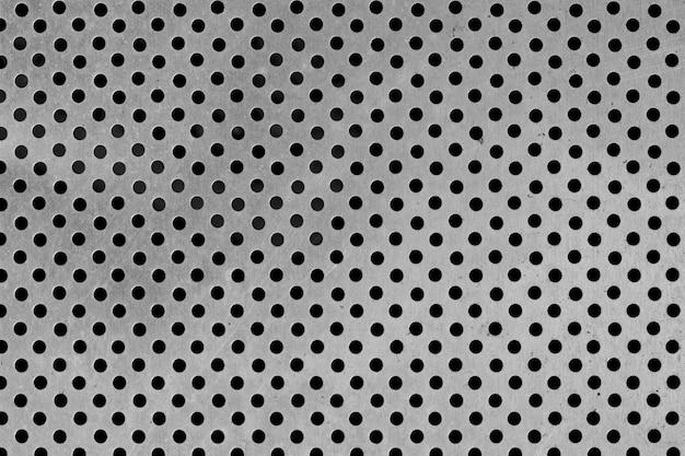 金属の背景のドットパターン