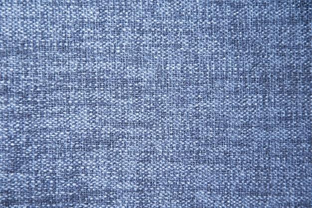 青い綿の布のテクスチャの背景。