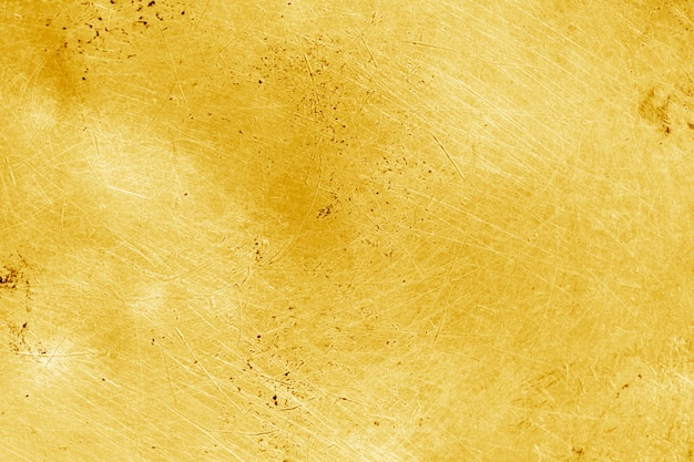グランジゴールドの背景色または質感