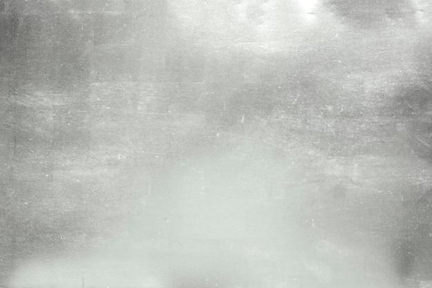 Алюминиевая предпосылка или текстура и тень градиентов. серебряный фон