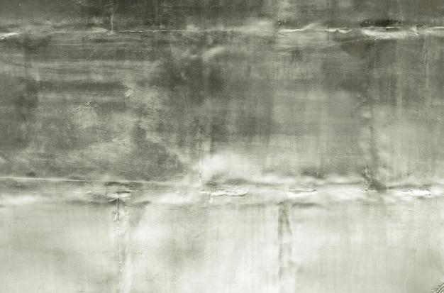 アルミニウムの背景色または質感とグラデーションの影。銀色の背景。