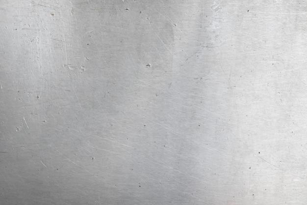 アルミニウムの背景色または質感とグラデーションの影。