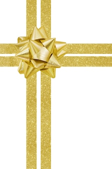 Смычок и лента подарка золота изолированные на белизне.