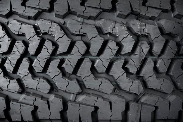 車のタイヤ、タイヤの質感のクローズアップ。