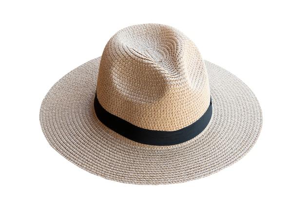 Винтажная милая соломенная шляпа изолированная на белой предпосылке. рядом с видом.