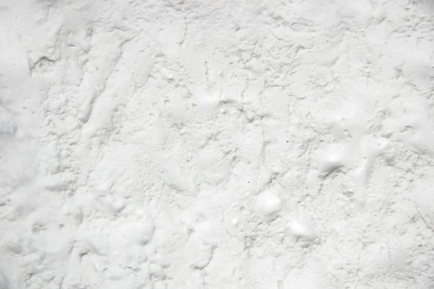 白い漆喰壁テクスチャ背景。