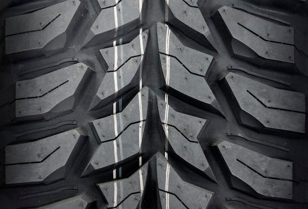 車のタイヤ、タイヤテクスチャのクローズアップ。