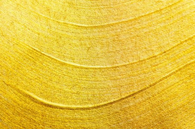 Детали текстуры золота абстрактной предпосылки.