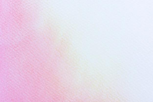 白地にピンクの抽象的な水彩画。紙にはねかける色。手描きです。