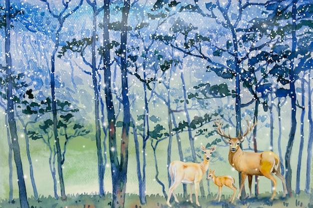 森の冬と鹿の家族に絵の雪が降る。