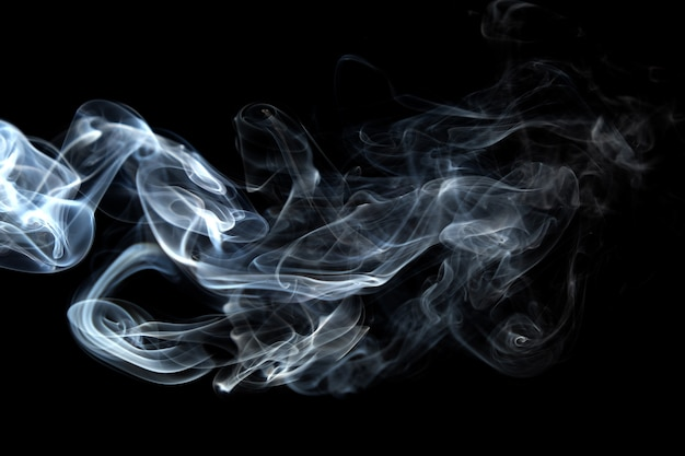 抽象的な背景の煙の曲線と波