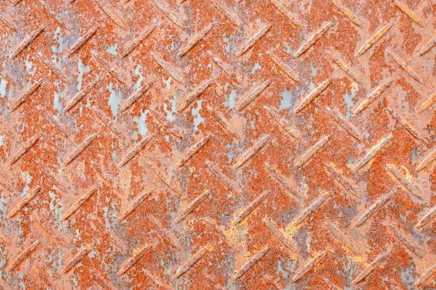 錆びたダイヤモンド鋼板の背景のテクスチャ