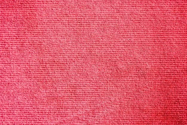 優雅な赤い色のカーペットのテクスチャ背景