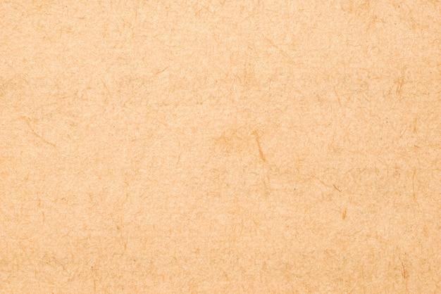 設計のための古いラフベージュ紙グランジ背景テクスチャ