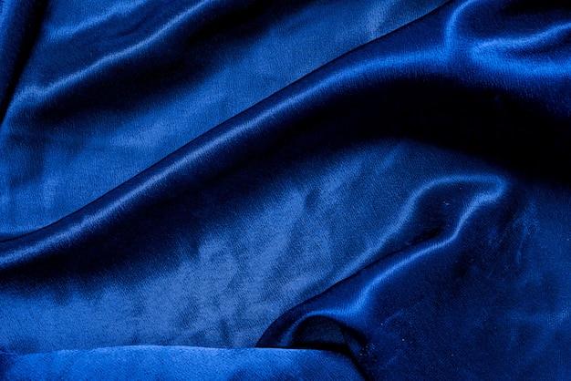 Синяя ткань ткань фоновой текстуры