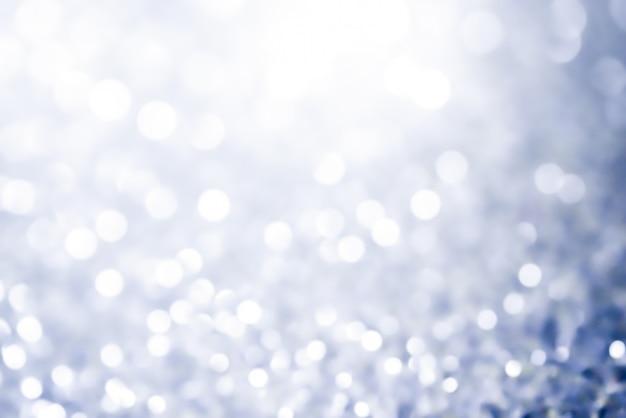 クリスマスボケ背景テクスチャ抽象的な光輝く星のボケ味。キラキラビンテージライトの背景