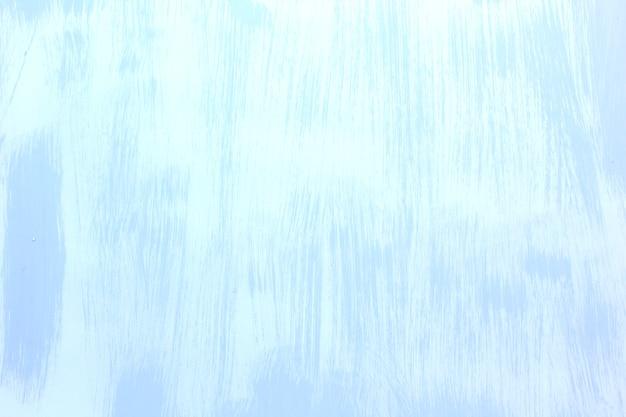 Запачканная предпосылка поверхности цемента в белой сини.