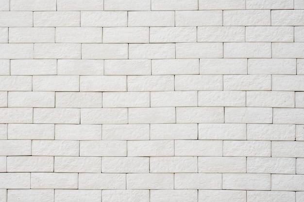 背景とテクスチャの白いレンガの壁。-画像