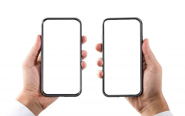 分離された空白の白い画面を持つスマートフォンを持っている手