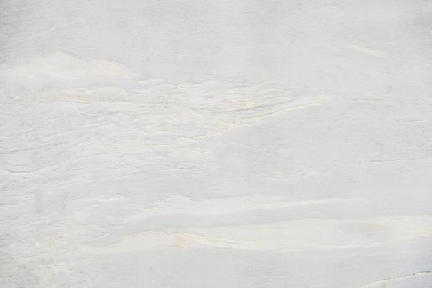背景と背景のための美しい抽象的な白大理石の岩と石のデザインパターンを閉じます