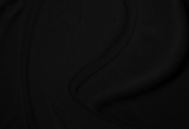 黒のシルク生地布背景とテクスチャのしわくちゃのクローズアップ豪華な背景デザイン。