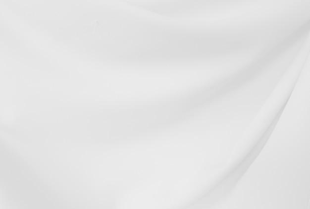 エレガントなクローズアップホワイトシルク生地の布と質感のしわくちゃ。