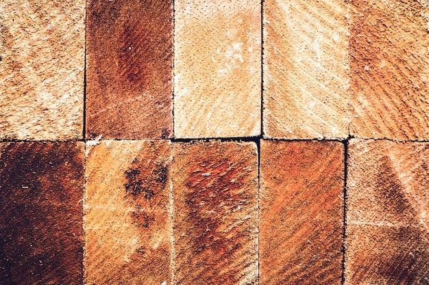 木の幹の長方形断面の断面をクローズアップテクスチャ背景