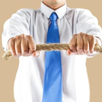 ビジネスマン、ロープ、保有物
