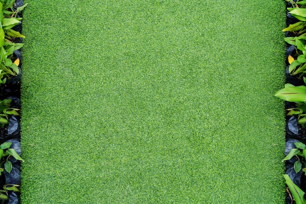 トップビューの写真、人工緑の草のテクスチャの背景
