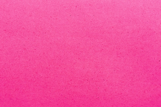 バックグラウンドのピンクの紙の質感。