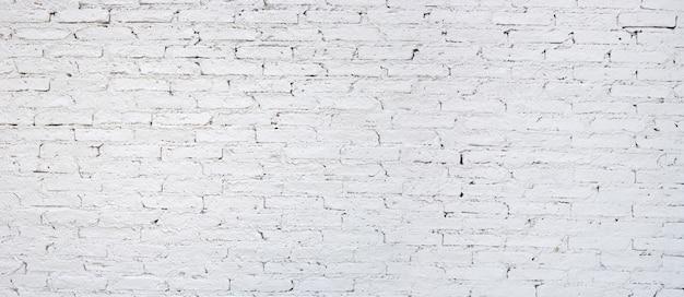 Белая кирпичная стена для предпосылки.