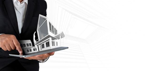 建築家またはデジタルタブレットと近代的な家の実業家