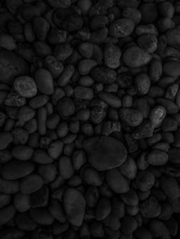 黒い小石の石のテクスチャ
