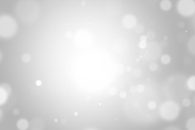 ボケ味を持つ銀の光クリスマス背景
