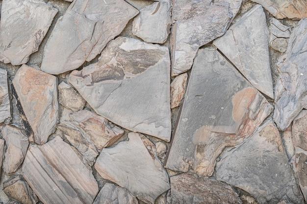 石の壁の背景。