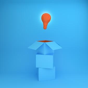 オレンジ色の電球は、創造的なアイデアをボックスの外で考えている。ビジネスコンセプト