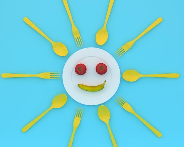 トマトとバナナは青い色のスプーンとフォークでプレートに笑顔を浮かべています。最小限