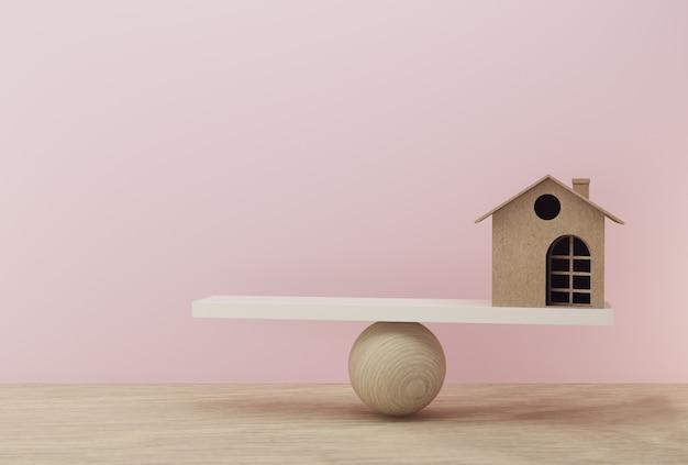 木製のテーブルとピンクの背景に等しい位置にバランススケールを家します。