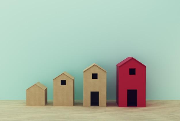 テーブルの上の赤い傑出した紙の家モデル