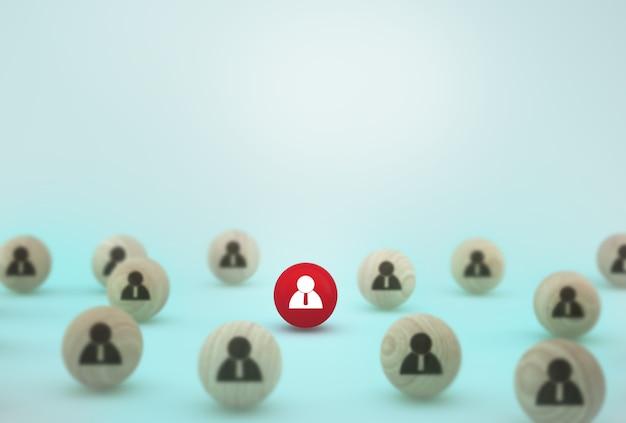 人的資源管理と採用ビジネスの従業員の概念の創造的なアイデア。青色の背景に木製の球体を配置