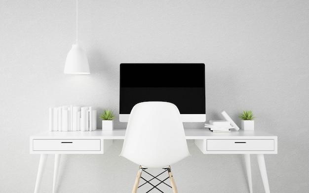 職場のテーブルに黒い画面コンピューター。フォルダーと文具。