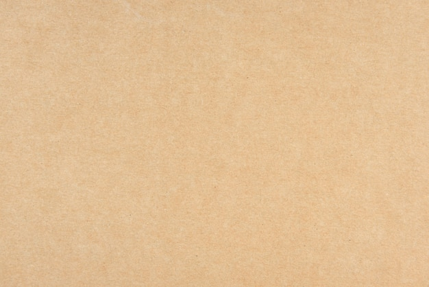 Старая предпосылка текстуры коричневой бумаги.