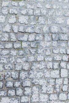 石造りの床の暗いテクスチャをクローズアップ