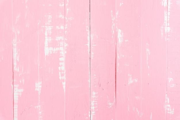 Пастель белого и розового деревянного стола фоновой текстуры