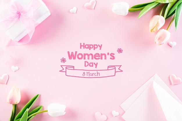 ピンクのパステル調の背景に国際女性の日の概念。