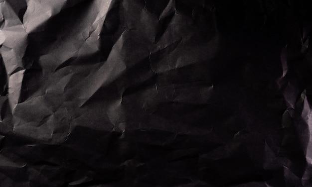 しわくちゃの黒い紙のテクスチャ。