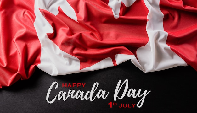 布のテクスチャとコピースペースを持つカナダの国旗。