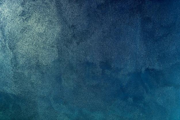 青のペイントの壁の背景のテクスチャ
