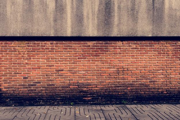 レンガの壁のオレンジの壁紙パターン